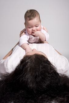 Baby On Top Of Mom Royalty Free Stock Photos