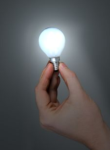 Free Hand Holding Glowing Light Bulb Royalty Free Stock Images - 8130819
