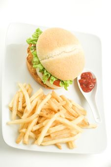 Free Crisp Chicken Burger Tomato Onion Cheese Lettuce Royalty Free Stock Image - 8130906