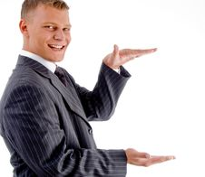 Free Young Smiling Businessman Measuring Stock Photography - 8131362