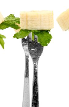 Banana Slices And Mint Leaves On Forks Royalty Free Stock Photos