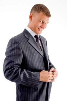 Free Smiling Young Manager Tucking His Coat Button Stock Photo - 8131670