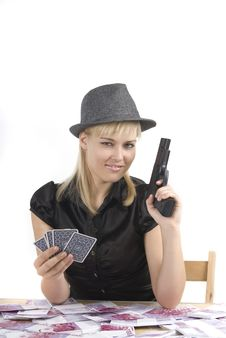 Woman Playing Poker With A Lot Of Money And A Gun Stock Photos