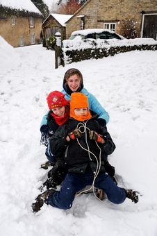 Free Kids Tobogganing In The Snow Royalty Free Stock Image - 8137166