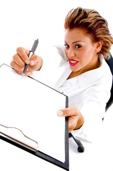 Free Female Doctor Writing On Notepad Stock Photography - 8137732
