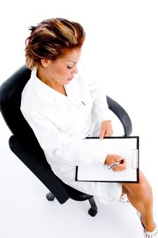 Free Female Doctor Writing On Notepad Stock Photos - 8137743