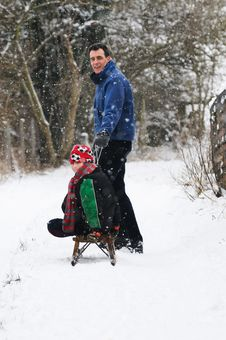 Free Father Pulling Son On Sledge Stock Photo - 8138580