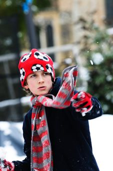 Boy Throwing Snowball Royalty Free Stock Images