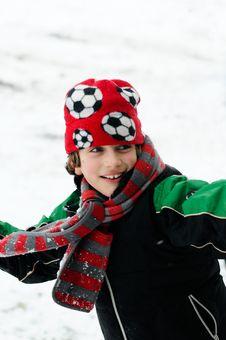 Free Boy Throwing Snowball Stock Photo - 8138830