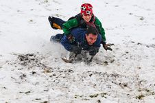 Father And Son On Sledge Stock Photos