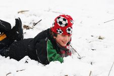 Boy Fallen In The Snow Royalty Free Stock Photo