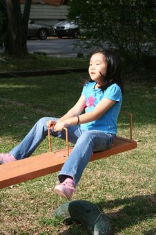 Free Girl Playing Seesaw Royalty Free Stock Photo - 8139295