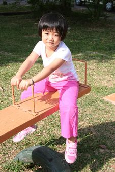 Free Girl On Seesaw Stock Photo - 8139630