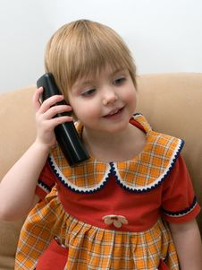 Free The Little Child With Phone Stock Image - 8141831