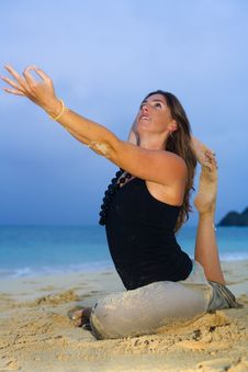 Young Woman Doing Yoga At The Beach Stock Image