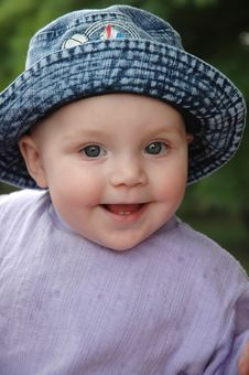 Baby Smiled In Blue Jean Hat Royalty Free Stock Photo