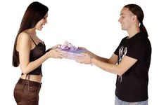 Young Man Giving A Gift To Young Woman Isolated Royalty Free Stock Photo