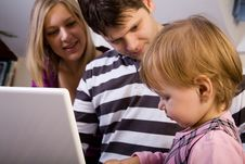 Little Girl With Parents Play With Laptop Stock Photography