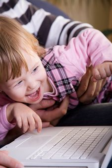 Free Little Girl Play With Laptop Royalty Free Stock Photography - 8144557