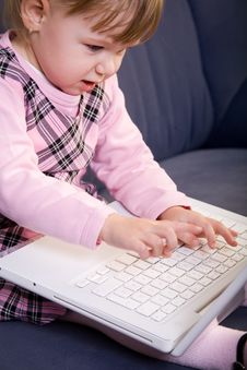 Free Little Girl Play With Laptop Stock Images - 8144654