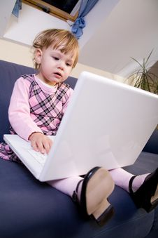 Free Little Girl Play With Laptop Stock Photo - 8144690