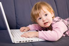 Free Little Girl Play With Laptop Stock Images - 8144774
