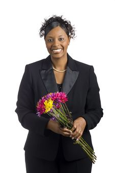 Free Black Woman Holding Flowers With Smile Stock Photo - 8146130