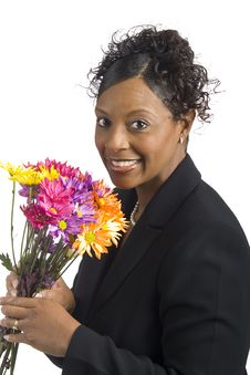 Free Black Woman Holding Flowers With Smile Royalty Free Stock Image - 8146136