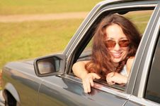 Free Woman Smiles In A Car Window Stock Photo - 8146990