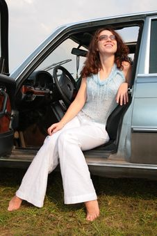 Woman Sits In The Car Stock Photos