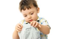 Free One Year Old Boy Putting On A Hat Stock Photography - 8148282