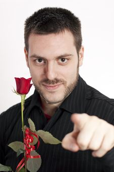 Man Smiling Hodling Red Rose Pointing His Finger