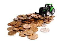 Green Tractor Raking Up Coins Stock Photography