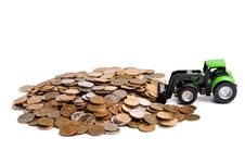 Green Tractor Raking Up Coins Royalty Free Stock Photography