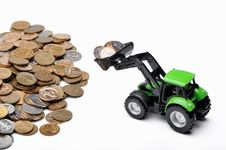 Free Green Tractor Raking Up Coins Stock Photography - 8149992