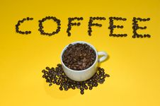 Free Coffee Written With Beans On Yellow Stock Photos - 8151903