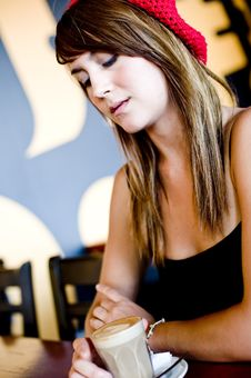 Free A Beautiful Young Woman Having Lucnh In A Cafe Stock Photo - 8159420