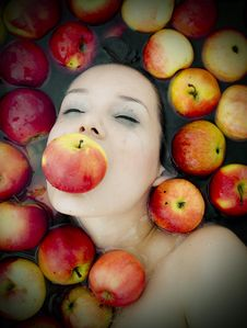 Girl In Apples Royalty Free Stock Images