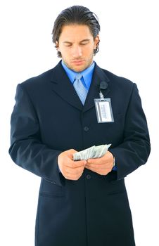 Free Confused Young Businessman Holding Money Stock Photography - 8160362