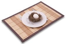 Free Egg In A Nest Served On A Plate Royalty Free Stock Images - 8160889