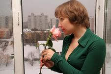 Young Woman With A Rose Stock Image