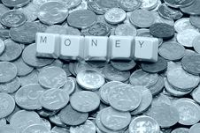 Free Money Word Over Different Metal Coins Royalty Free Stock Image - 8165666