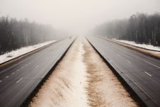 Free Snowy Highway In The Dark Foggy Forest Stock Photography - 8165722