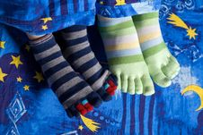 Free Two Pairs Of Feet In Socks Stock Images - 8165904