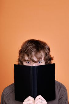 Free Man Looking Over The Book Stock Photos - 8166113
