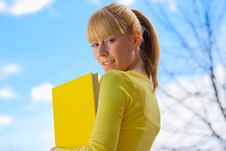 Free Beautiful Blond Girl With Yelow Book Royalty Free Stock Photos - 8166918