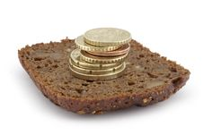 Free Pyramid From Coins On A Slice Of Bread. Stock Images - 8170504