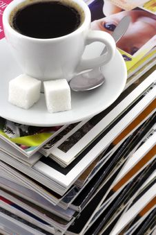 Free Cup Of Coffee On A Pile Of Magazines. Royalty Free Stock Images - 8170509