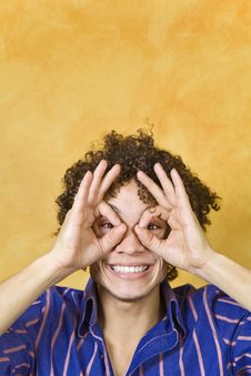 Man Smiling With Hand Over Eyes Royalty Free Stock Photo