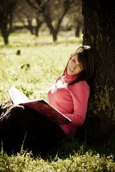 Free Enjoying A Book In The Forest Royalty Free Stock Photos - 8171688